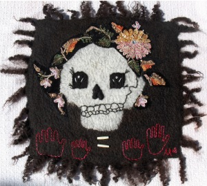 wool, sequins, thread, bone; handfelted, handstitched, embroidered